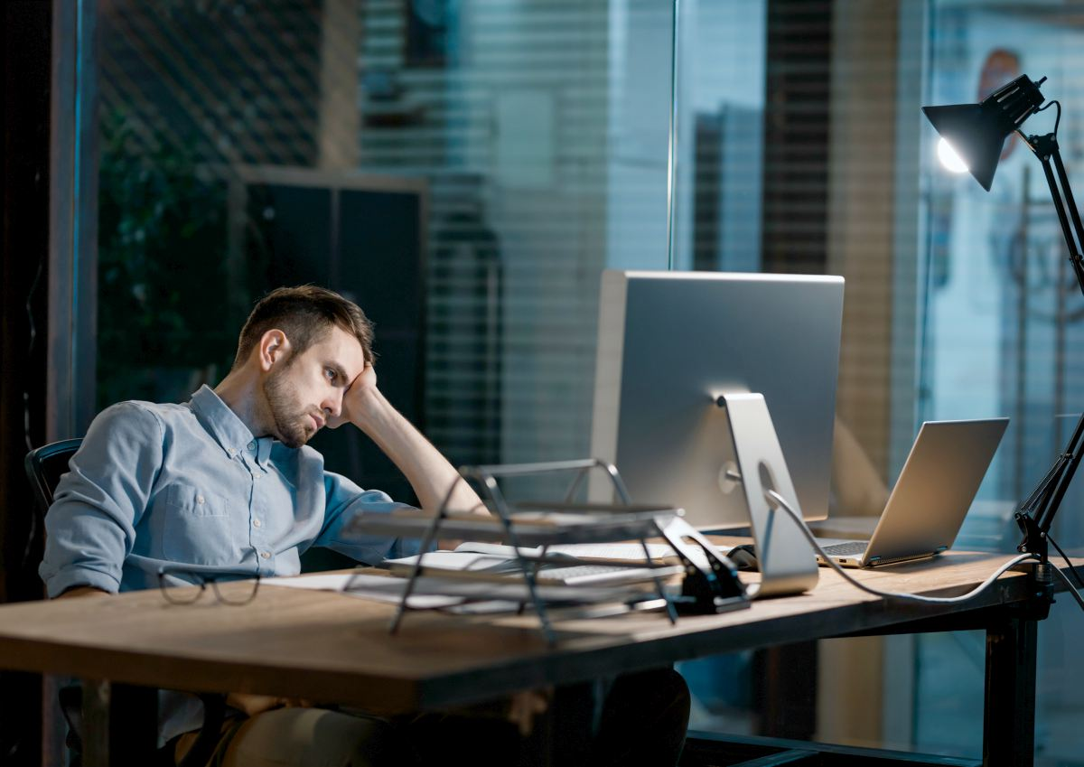 Man stressed at work | Sodium Solutions For Your Salt Cravings [INFOGRAPHIC] | salt cravings causes