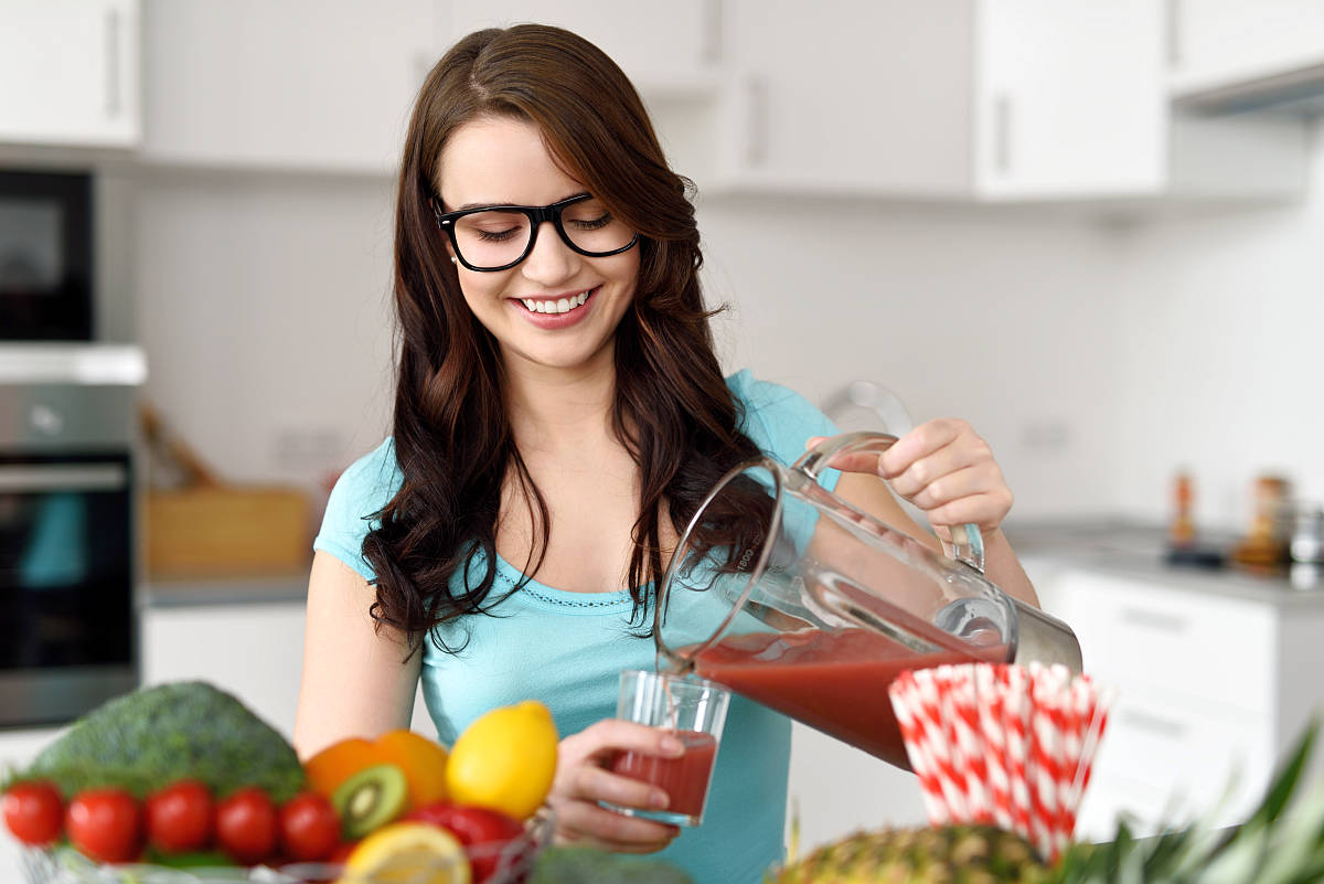 Happy healthy young woman wearing glasses | Why Gut Health Matters More Than You Think