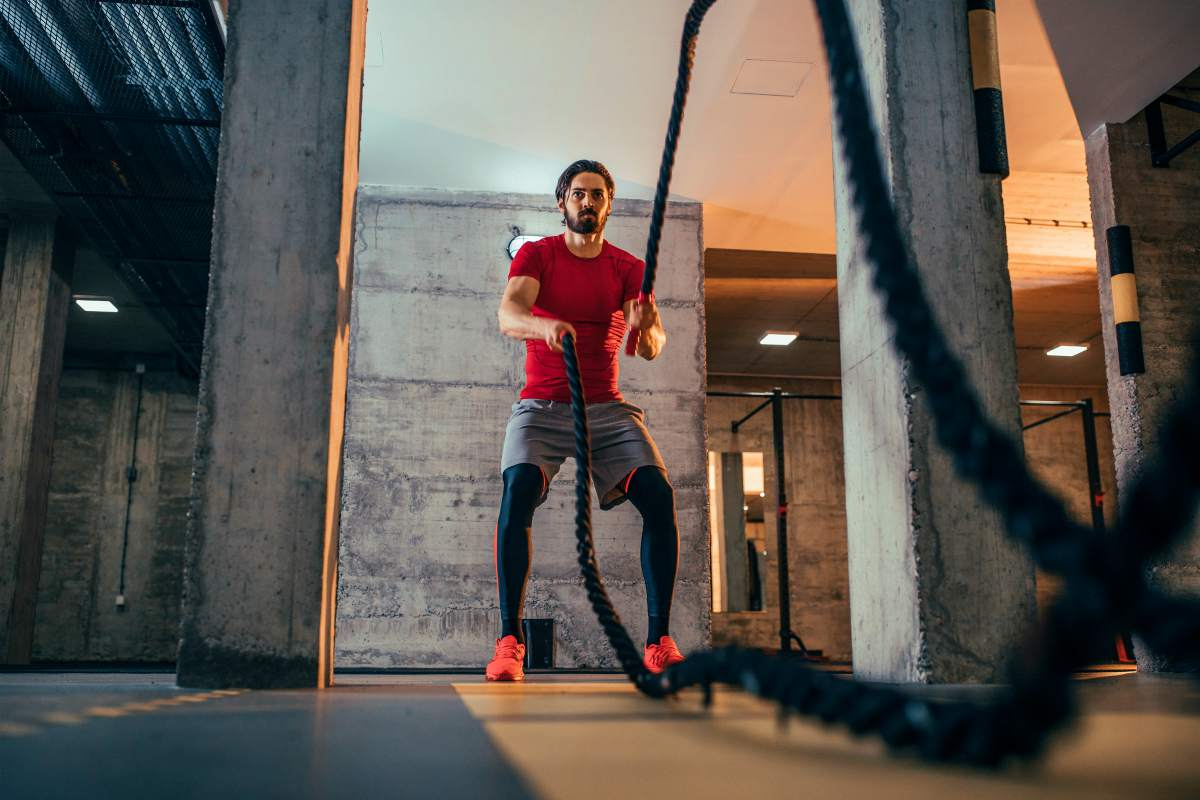 Shot of a sporty young man working out with battle ropes at the gym | Enzymes… A Health Miracle? | Enzymes