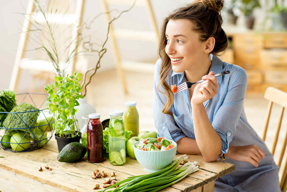 Young happy woman eating healthy salad | Why Gut Health Matters More Than You Think