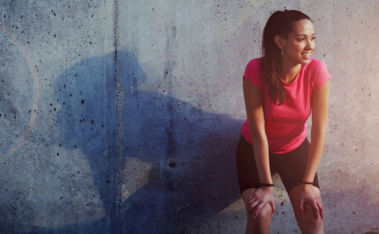 Feature | Young smiling female resting after an active fitness training | Enzymes… A Health Miracle? | Enzymes