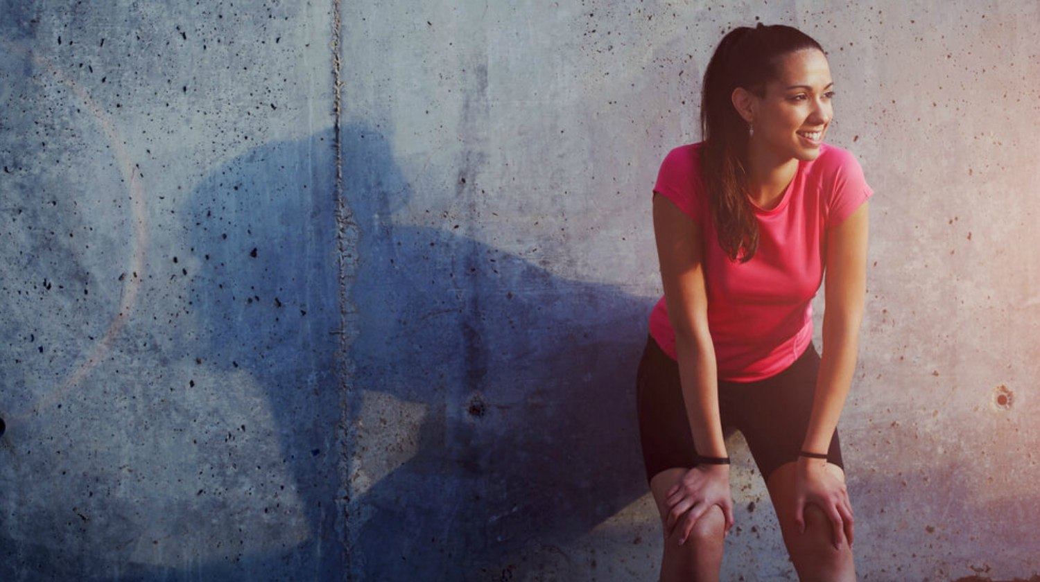 Feature | Young smiling female resting after an active fitness training | Enzymes… A Health Miracle?| Enzymes