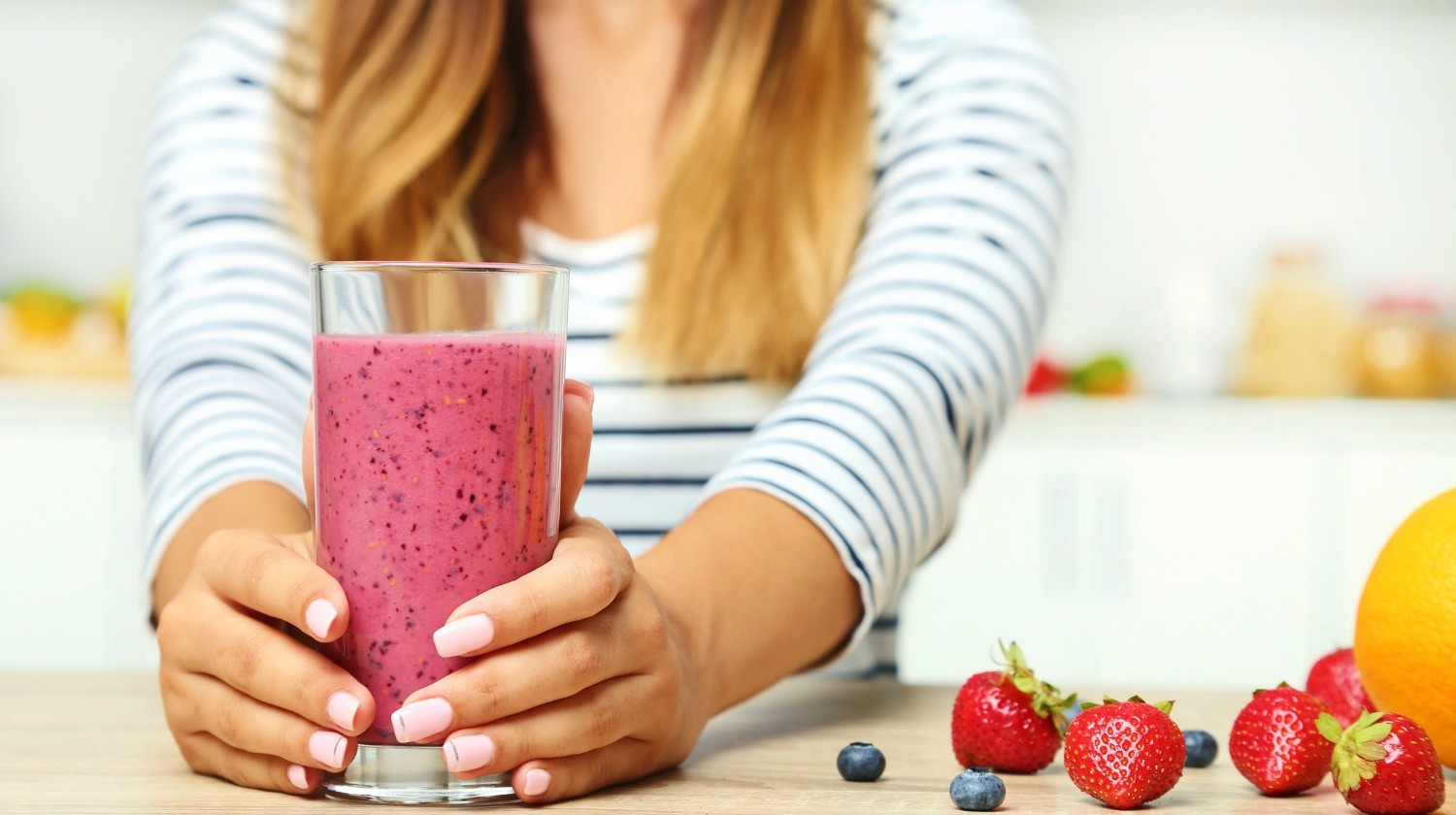 Feature | Woman drinking smoothie | Is The Fructose In Fruit Making You Fat And Sick?
