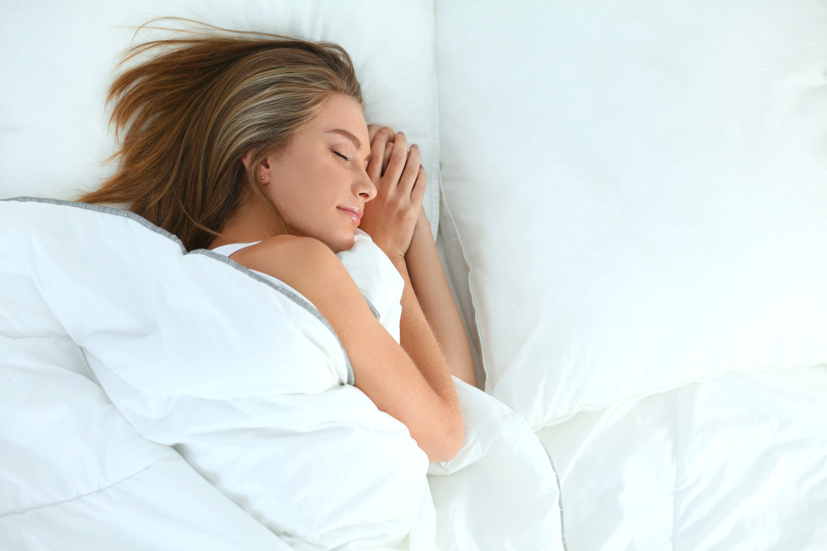 Beautiful girl sleeps in bed | Leaky Gut: 9 Tips On How To Heal It Naturally
