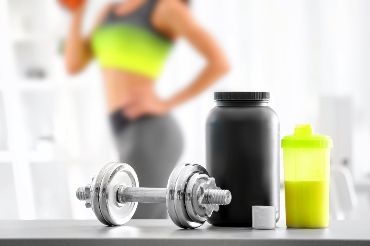 protein shake and blurred woman on background | What Is A Branched Chain Amino Acid (BCAA) And How Does It Help The Body? | bcaa