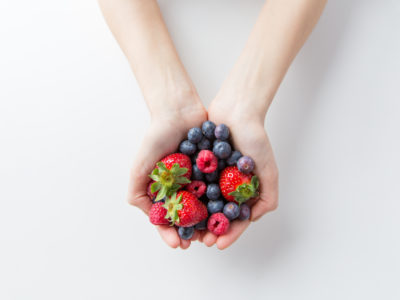 photo of person holding berries in both hands