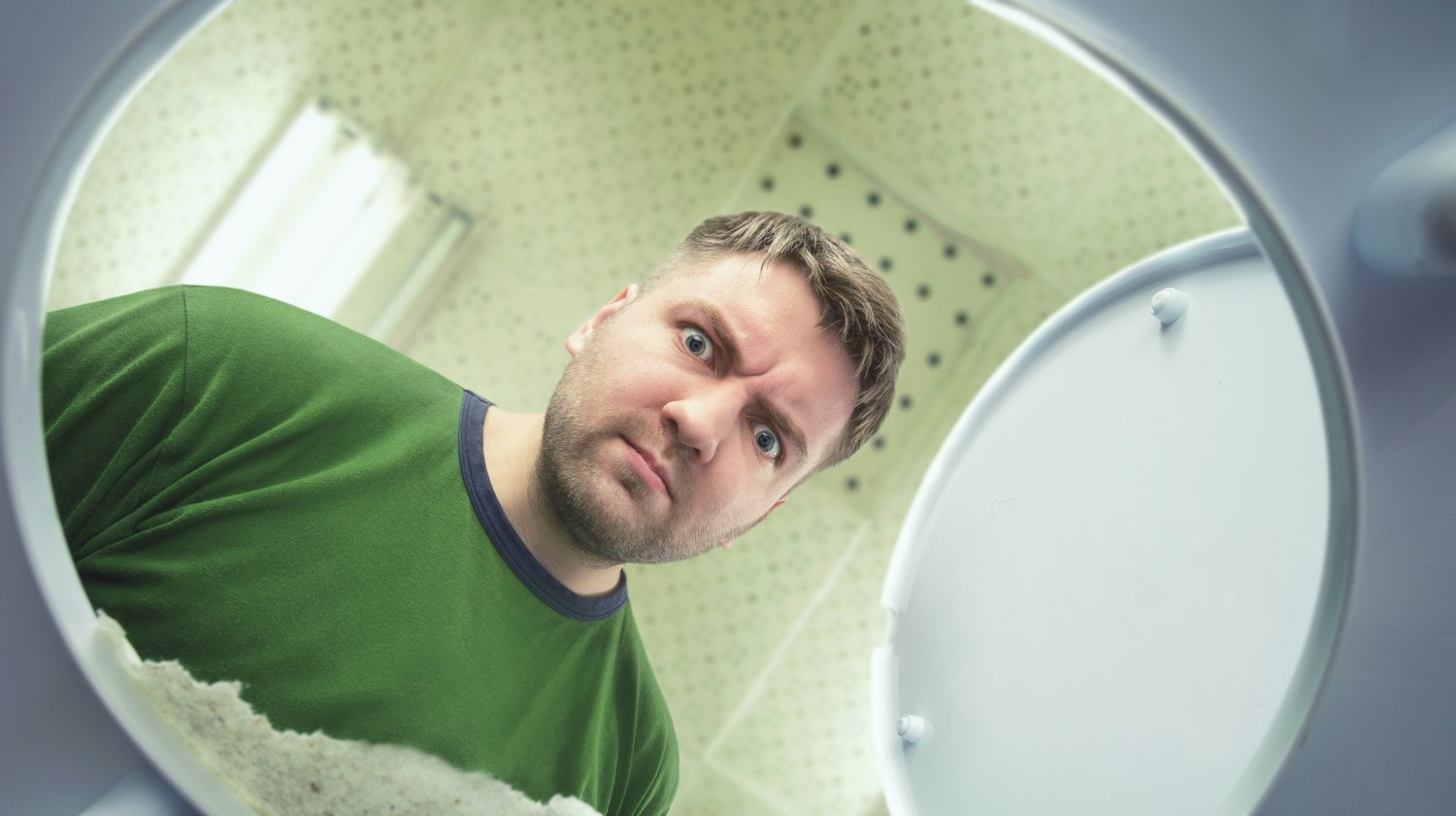 Feature | man looking at toilet | Things Your Poop Color Is Telling You About Your Gut Health | poop