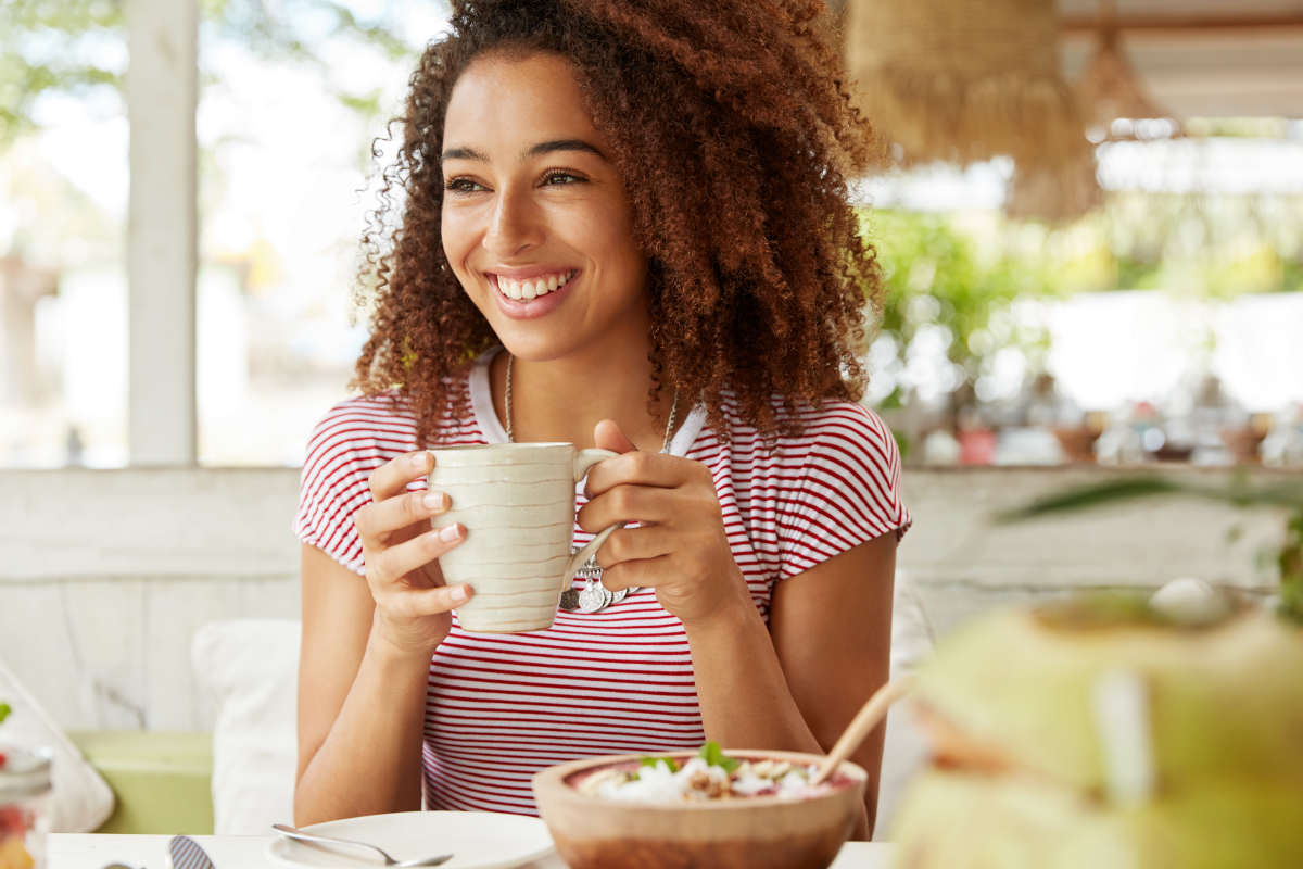 Photo of positive dark skinned mixed race female | The Relations Between Stress, Trauma, And Autoimmune Conditions | stress