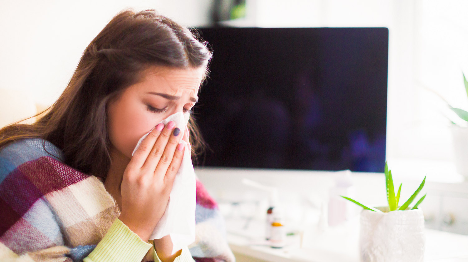 Feature | Side view of the young sick woman who sitting in the office | The Relations Between Stress, Trauma, And Autoimmune Conditions | stress