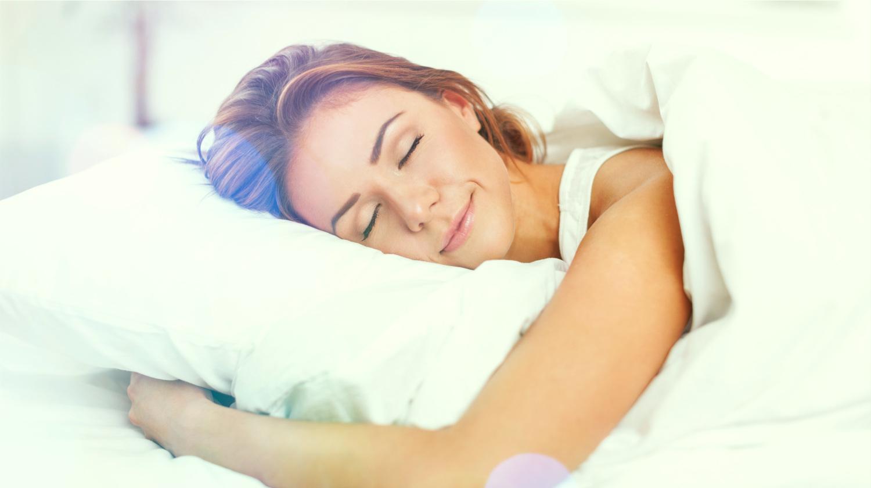 Feature | woman sleeping soundly inside room | Sleep Tips Arianna Huffington Swears By