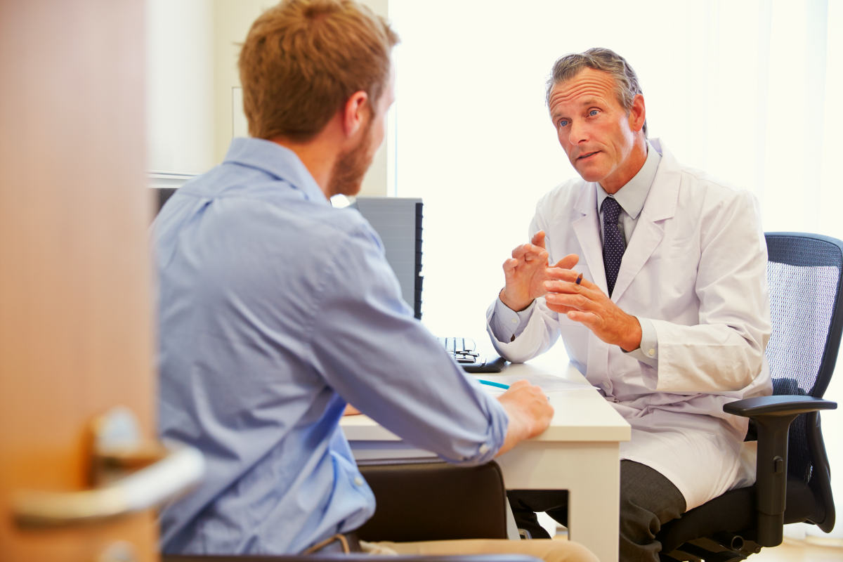 Male Patient Having Consultation With Doctor In Office | What Is Leaky Gut Syndrome And How Does It Affect Your Health?