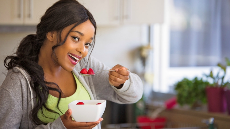 Featured | Young fit and healthy woman eats from a bowl of fruit | What Is Ellagic Acid? Foods That Contain Ellagic Acid