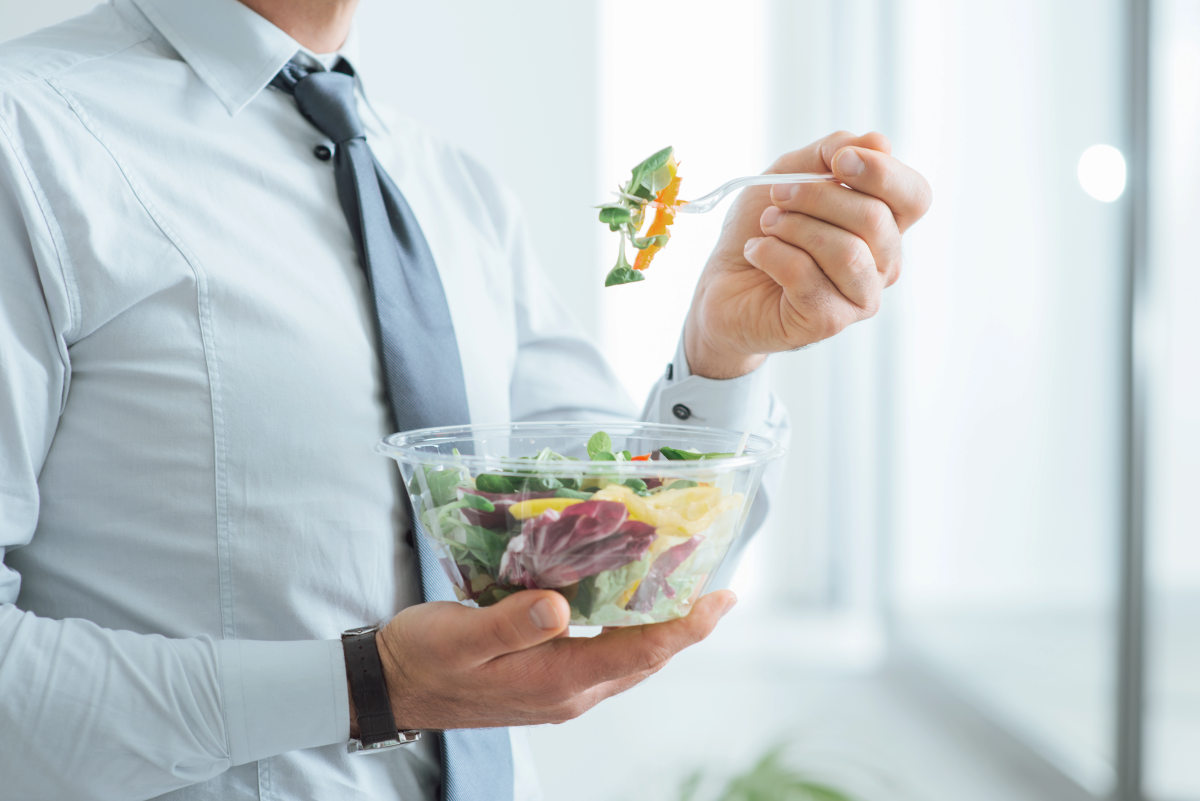 Businessman having a vegetables salad for lunch | Foods To Add To Your Microbiome Diet