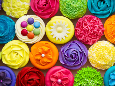 Photo of colorful cupcakes with synthetic food coloring