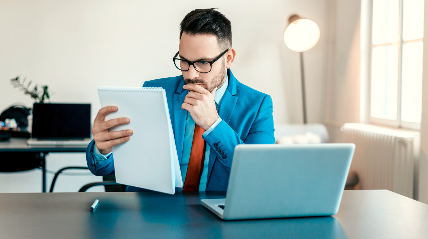 Feature   Concentrated young businessman reading documents at office desk   Natural Brain Vitamins To Improve Your Memory And Focus