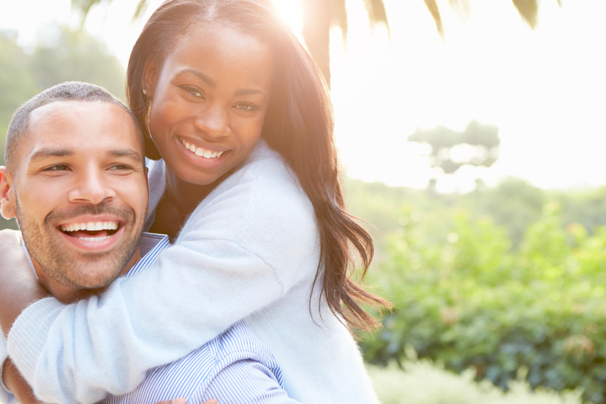Happy African couple | How A Balanced Microbiome Promotes Higher Energy Levels