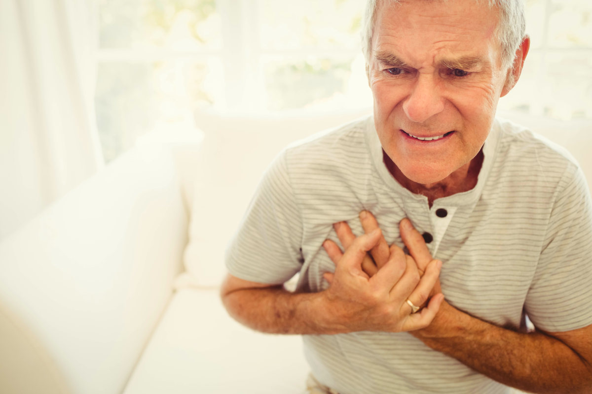 Senior man with pain on heart in bedroom | Risks Of High TMAO And How To Reduce TMAO Levels
