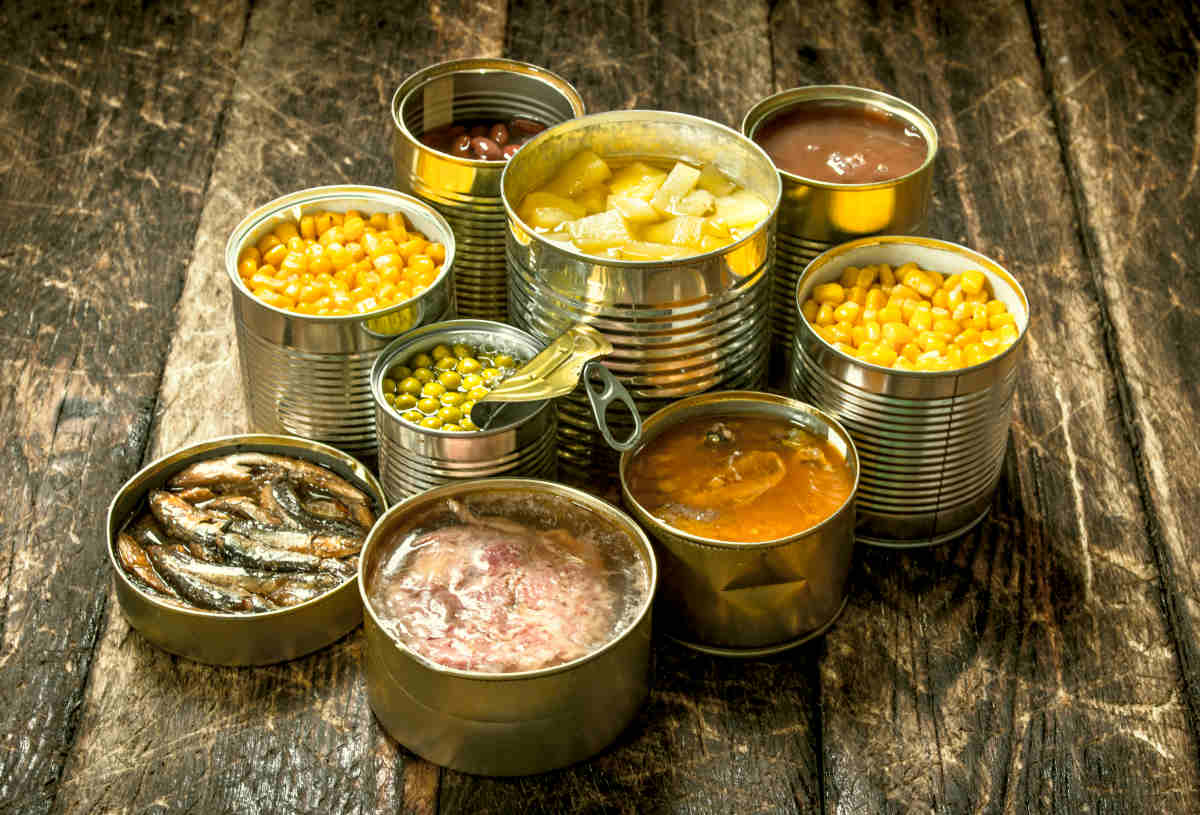 Various canned vegetables, meat, fish and fruits in tin cans | Foods To Exclude From Your Gut Health Diet