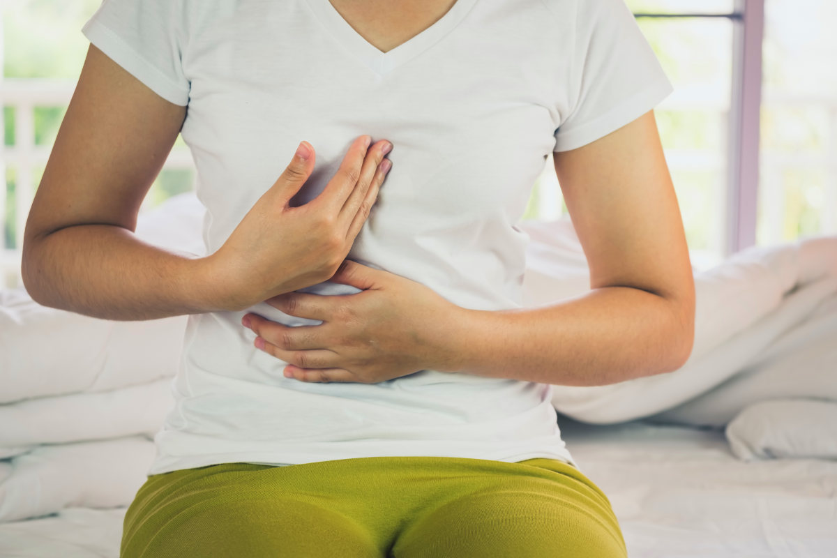 Woman Burning in the chest suffering from acid reflux | Can Too Much Protein Cause Inflammation?