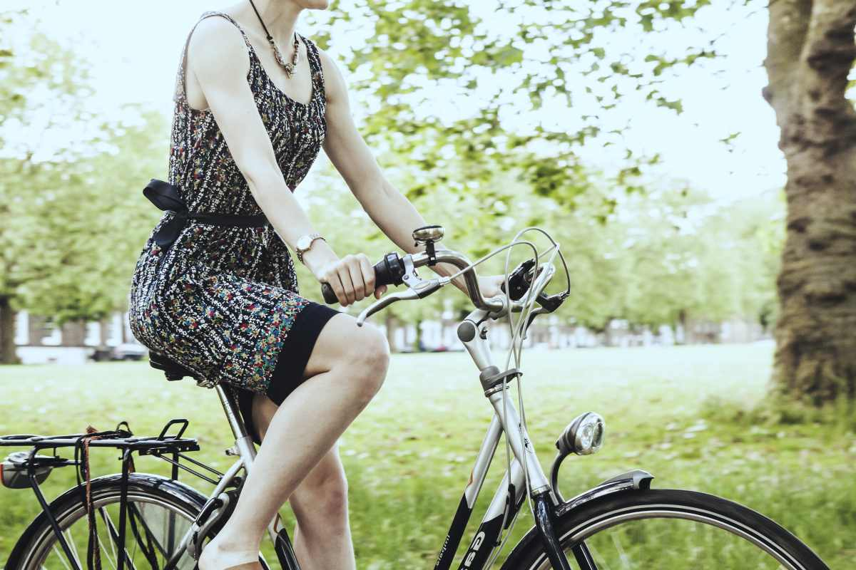 woman riding a bike | Tips To Keep The Stress Away During Busy Summer Months | remove stress