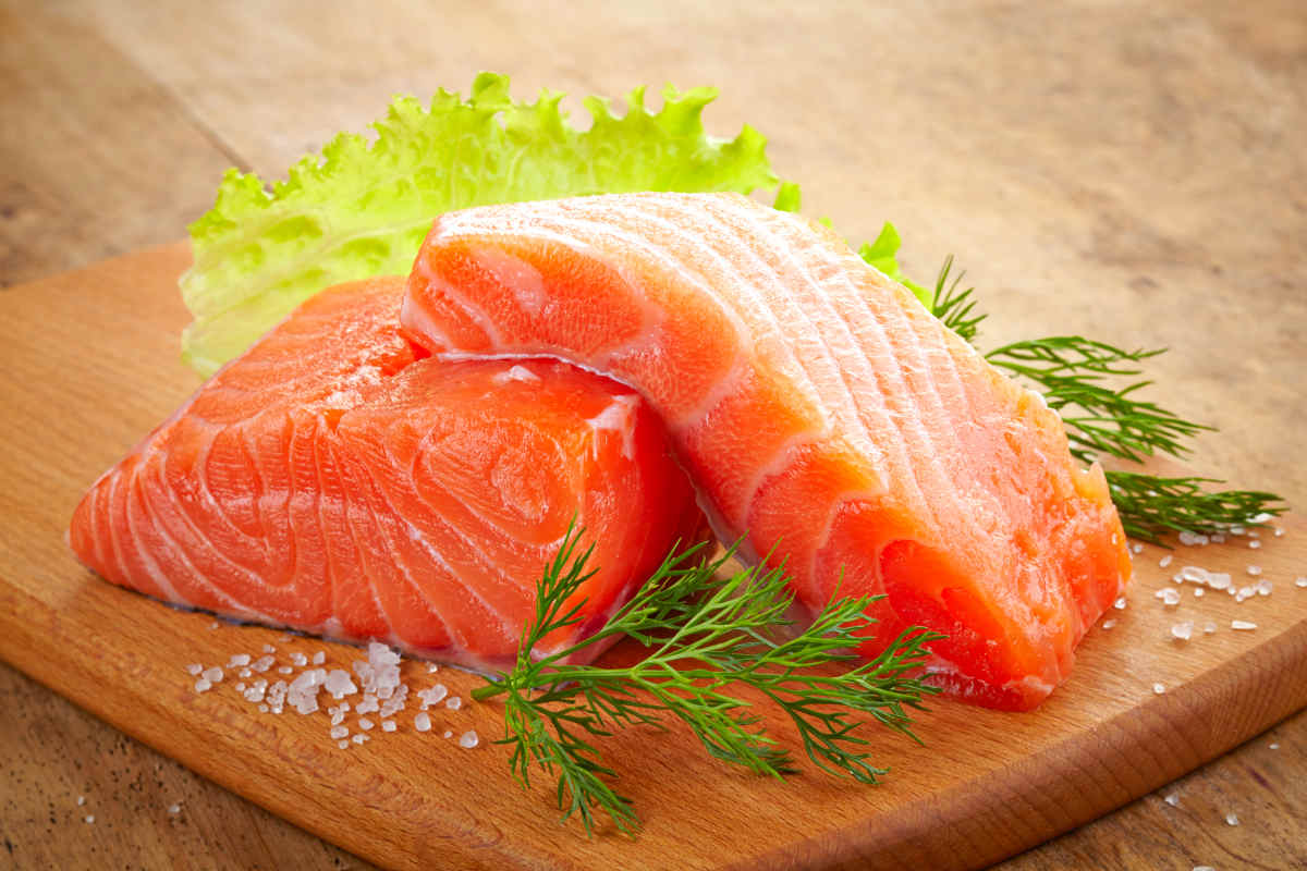 Fresh raw salmon on wooden cutting board | Foods To Boost Your Brain Power