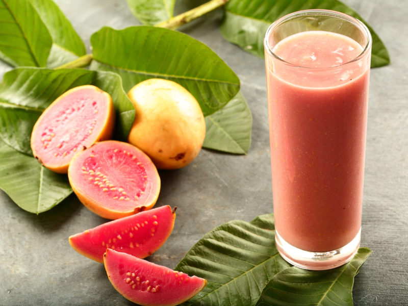 photo of cut up guava and glass of guava juice
