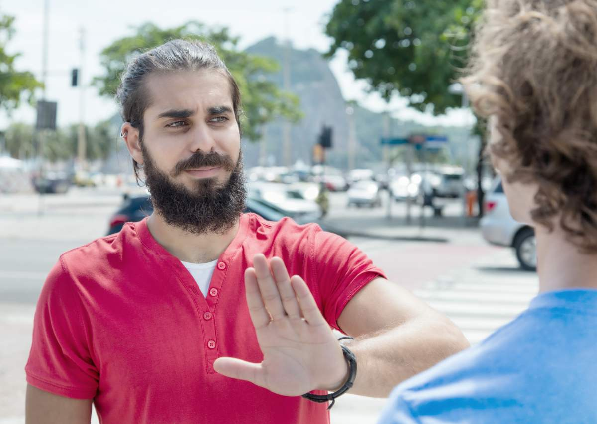 man saying no | Tips To Keep The Stress Away During Busy Summer Months | ways to relieve stress