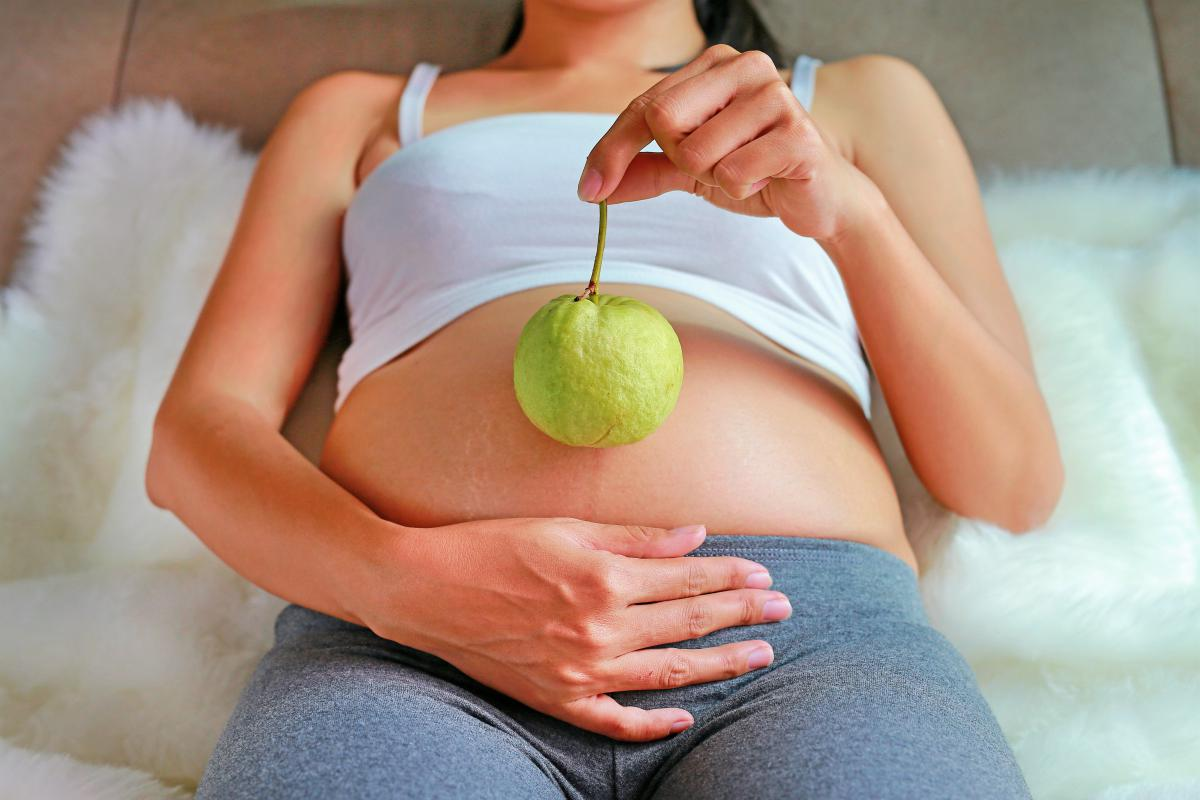 pregnant woman holding guava | The Medicinal Properties of Guava And Its Leaves | guava tree | guava benefits