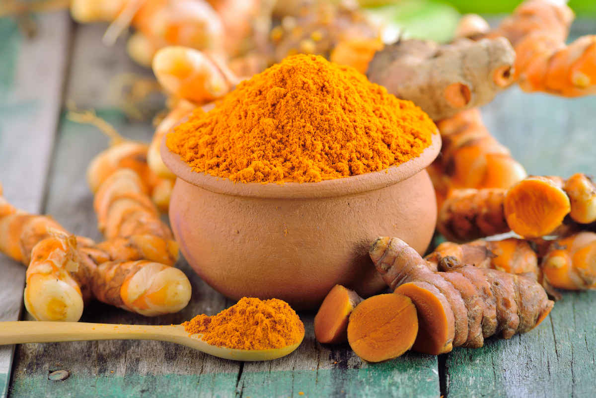 Turmeric roots in the basket on wooden table | Foods To Boost Your Brain Power