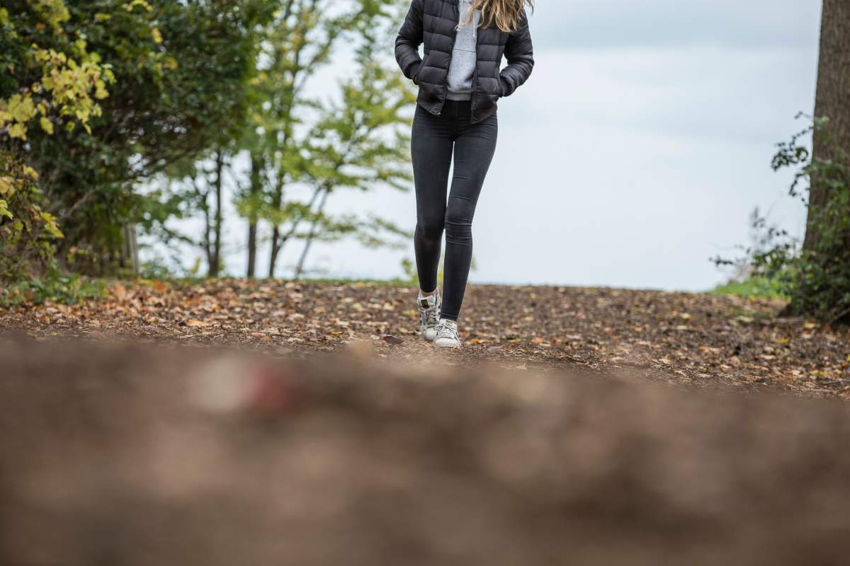 woman in black walking in park | Can't Focus? 11 Ways To Improve Your Concentration Naturally | how to improve your focus