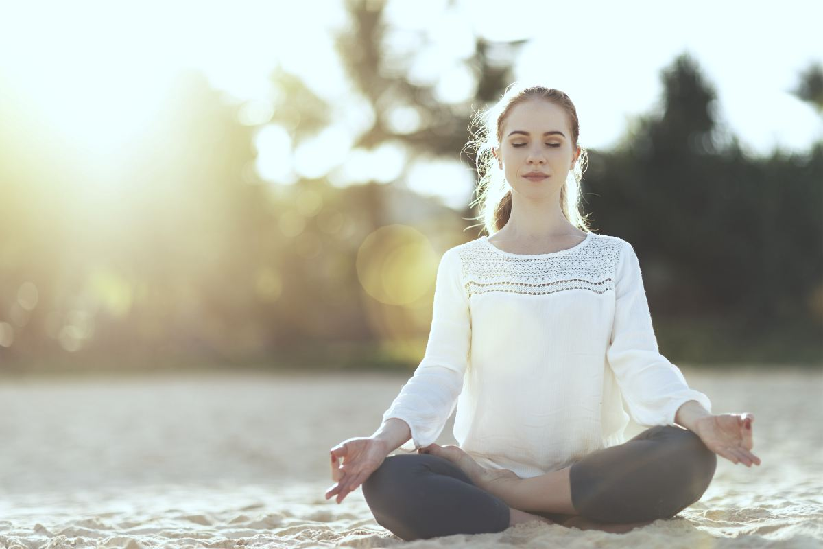 woman meditating | Tips To Keep The Stress Away During Busy Summer Months | how to relieve stress