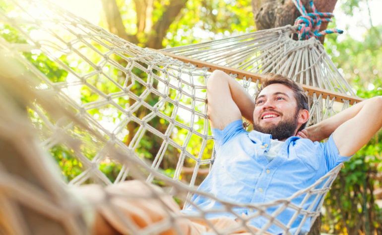 Feature | Young caucasian man swinging in a hammock | How To Overcome Emotional Pain Naturally