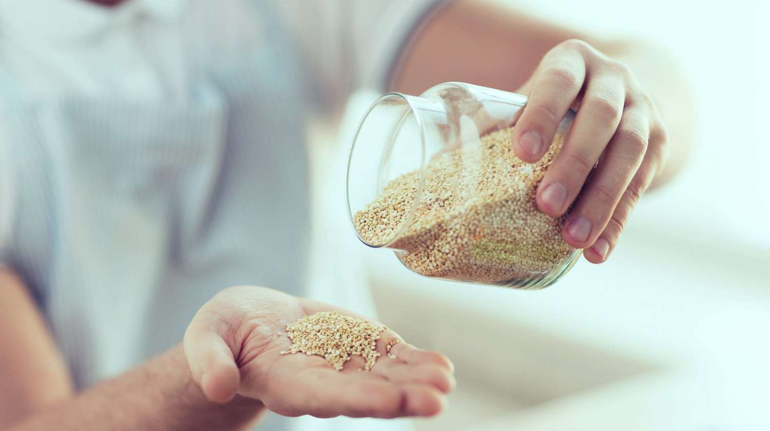 Featured | person emptying jar of quinoa | Quinoa: 6 Benefits And How To Cook Quinoa In Minutes | how to make quinoa | how to cook quinoa
