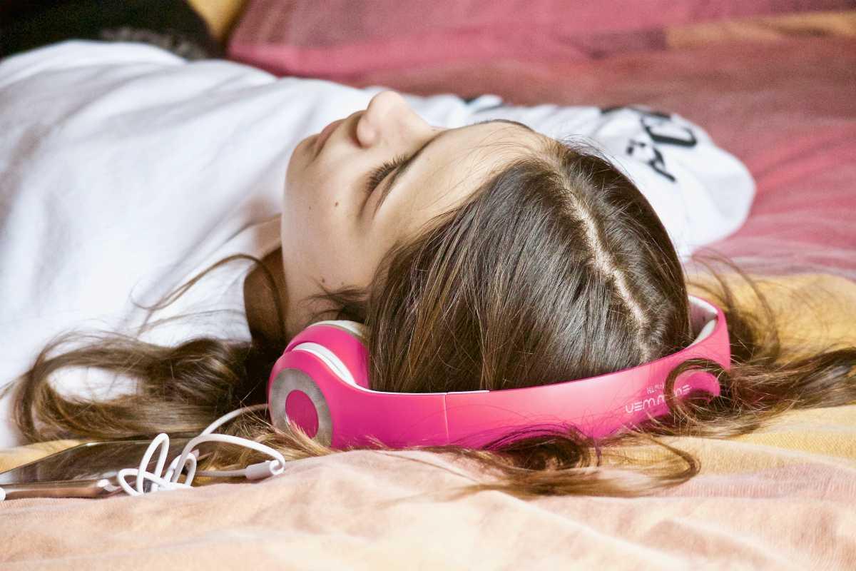 girl relaxation listening music   Can Sleep Music Really Help You Sleep Better? (According To Science)   music for sleep