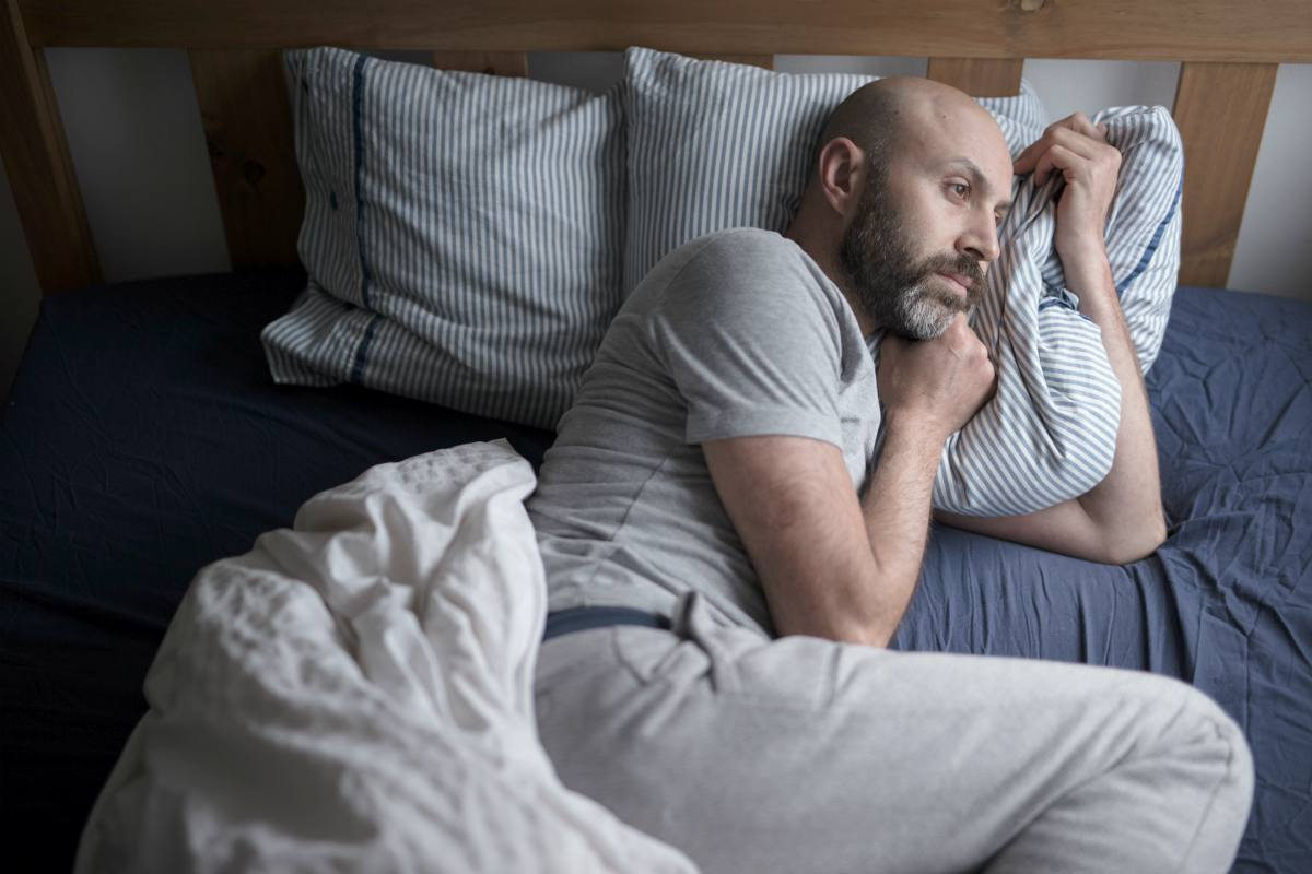 man having sleeping problem | What Is Health Anxiety And How Can You Beat It? | health anxiety | how to stop health anxiety symptoms