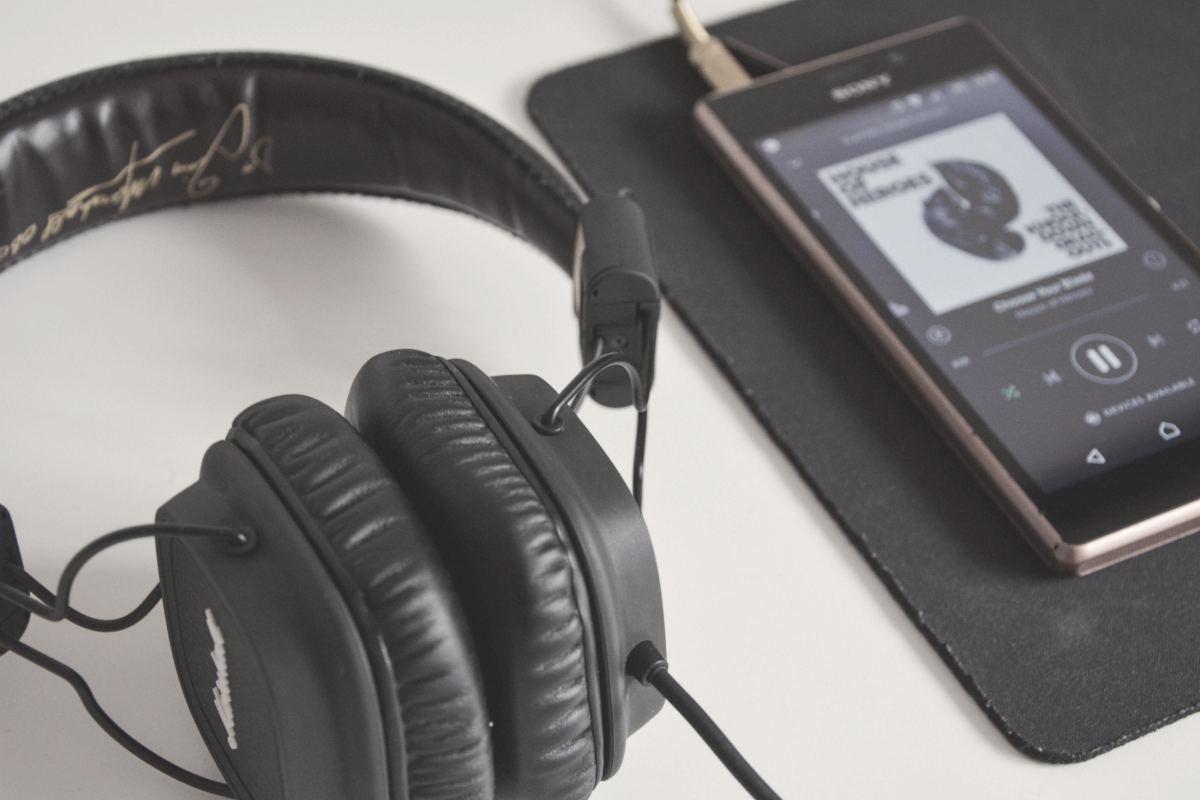 phone and headphone   Can Sleep Music Really Help You Sleep Better? (According To Science)   deep sleep music