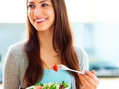photo of woman eating salad for intermittent fasting