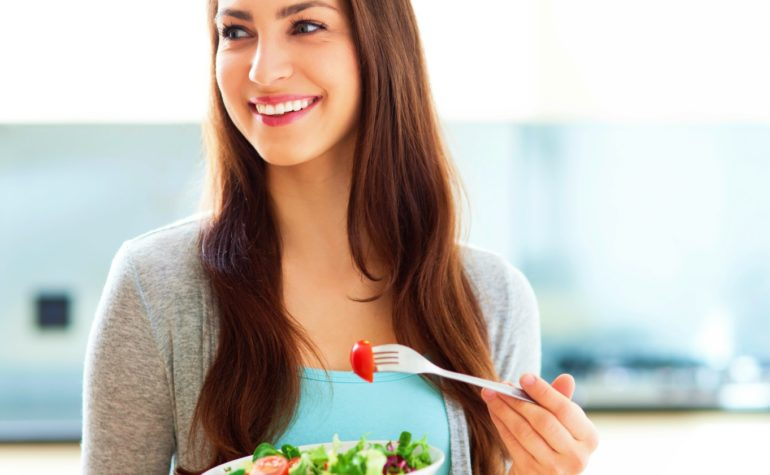 Featured   woman smiling eating salad   Intermittent Fasting Tips And Tricks For Better Results   intermittent fasting