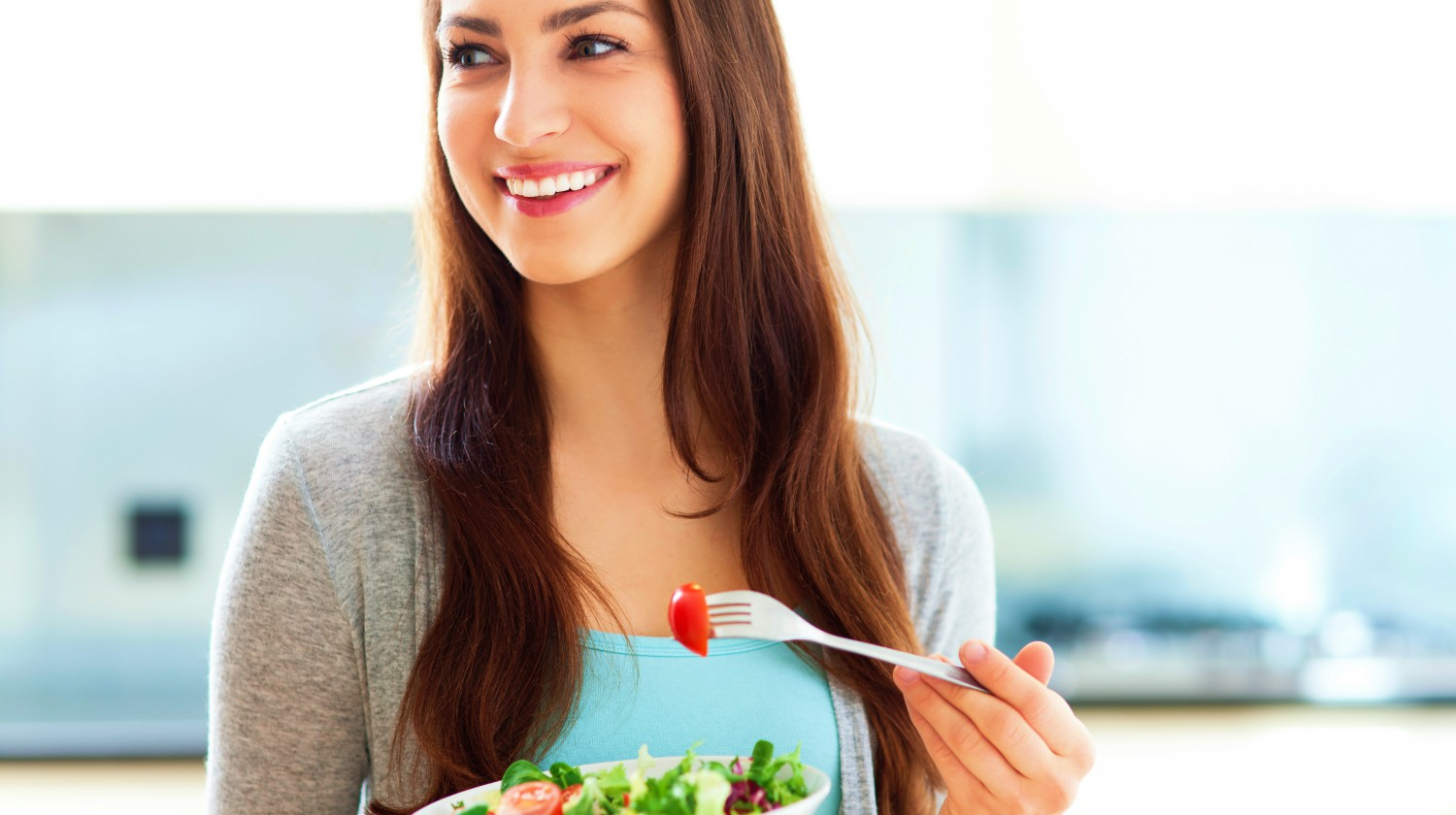 Featured | woman smiling eating salad | Intermittent Fasting Tips And Tricks For Better Results | intermittent fasting