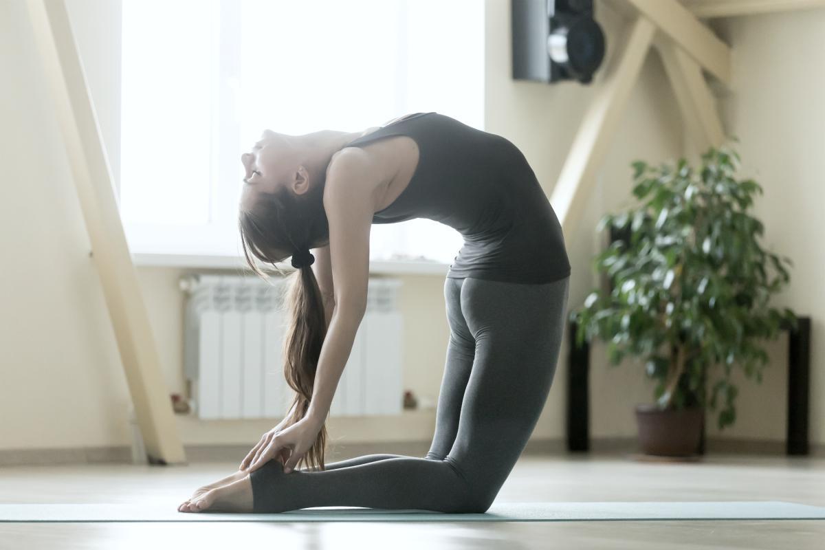 woman doing yoga pose | Why Consider Playing Music During Yoga Practice | yoga music | youtube yoga music