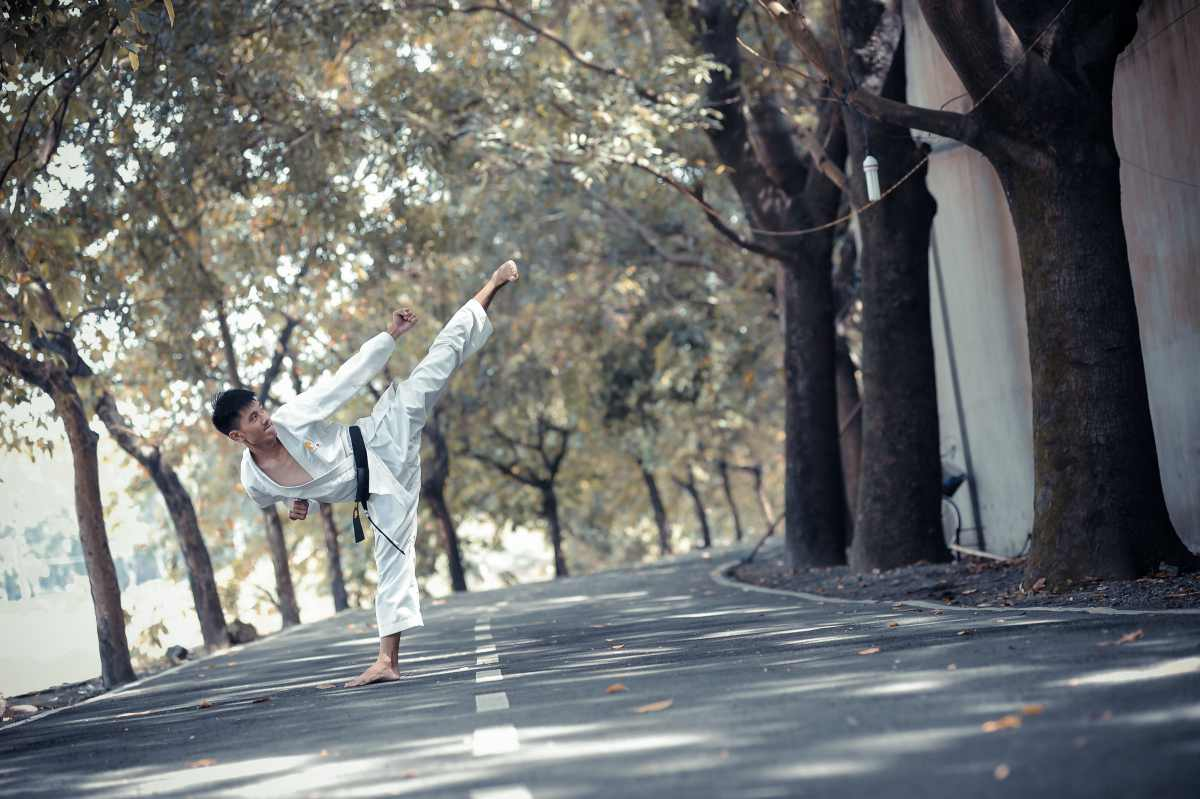 asian young teen man doing karate kick by the street   types of martial arts   types of martial arts self defense   all types of martial arts