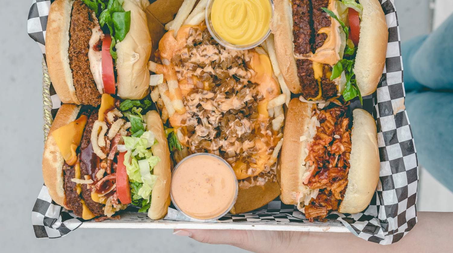 top view of tray of burgers and fries with mayo and cheese   fast food   keto fast food   low carb fast food   best fast food salad   Featured