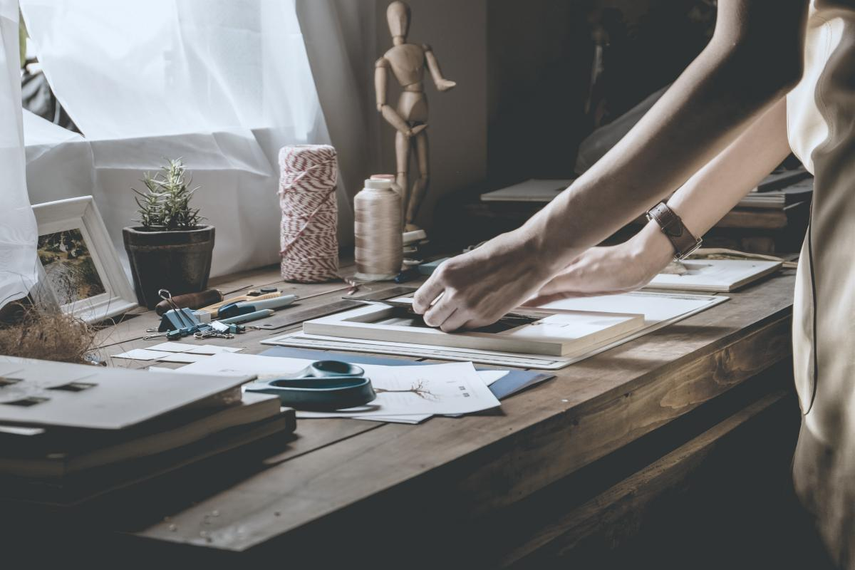 woman hand crafting book arts and crafts on table | grow financial | sustainable investing | sustainable source of income