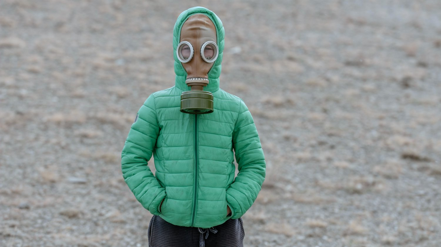 kid wearing gas mask outdoor | no trees | natural environment | natural toxins | environmental toxins | Featured