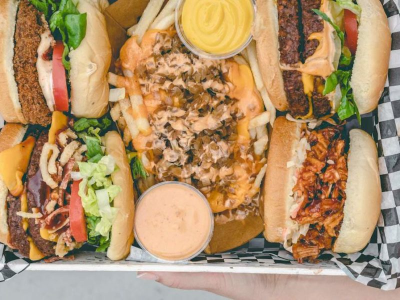 photo of a big tray of fast food burgers and sandwiches