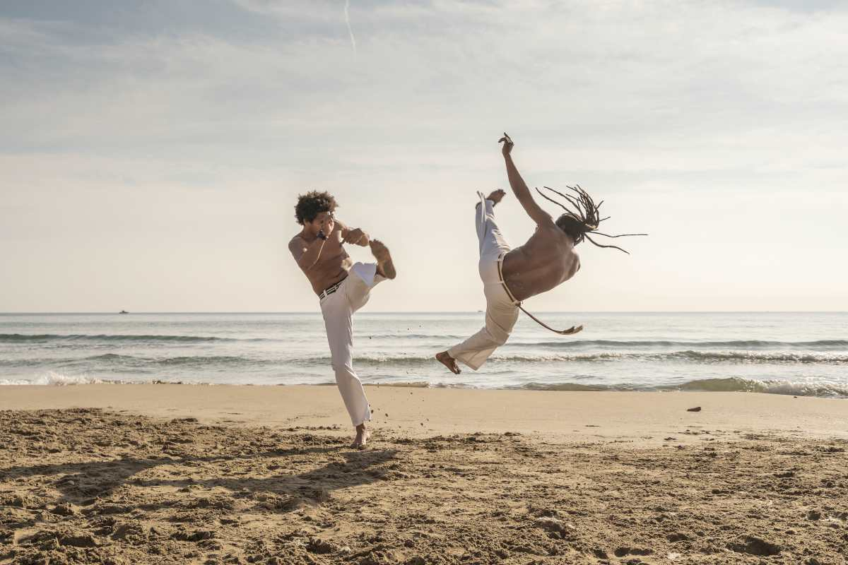two men doing capoeira by the beach   types of martial arts   how many types of martial arts are there