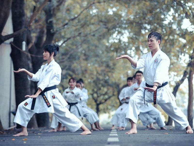 image of people doing karate on the road