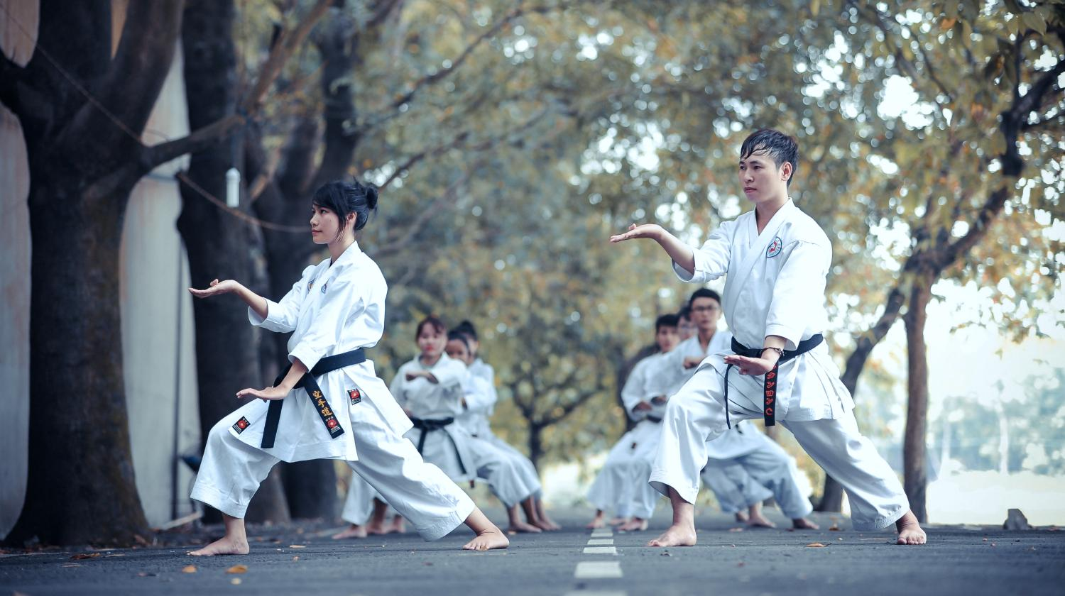 asian teens performing martial arts karate on the street | types of martial arts | different types of martial arts | Featured