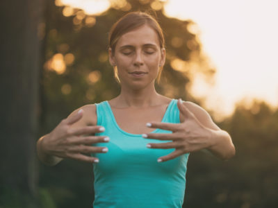 photo of woman practicing qi gong outdoors