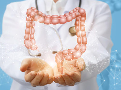 doctor holding hologram of a colon